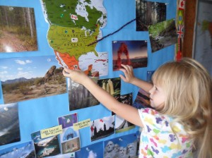 K is placing the flag sticker on the map of Mexico