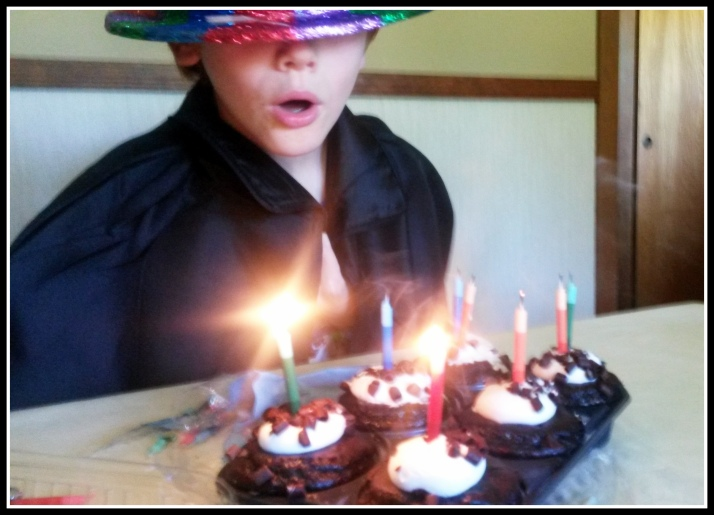 8 Candles on his Cupcakes